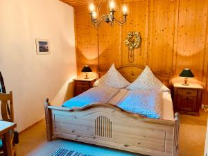 A bed or beds in a room at Landhaus Tannenhof