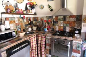 A kitchen or kitchenette at Guesthouse Nuvole