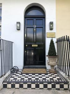 The facade or entrance of The Montpellier Townhouse