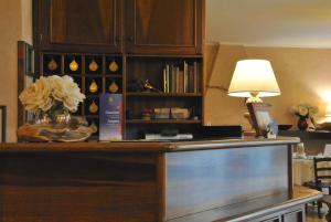 Лобби или стойка регистрации в Hotel Pavone