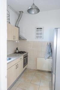 A kitchen or kitchenette at Fleurdelis