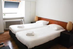 A bed or beds in a room at Hotel Benno