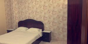 Cama ou camas em um quarto em Al Awael Furnished Units