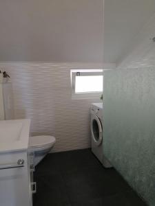 Kúpeľňa v ubytovaní Apartments Atrium Malinska