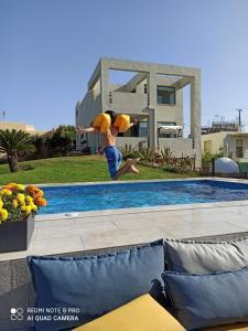 The swimming pool at or near Villa Detoro