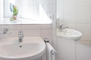 Ванная комната в Hotel Allegro Einsiedeln