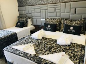 A bed or beds in a room at Venus Hotel