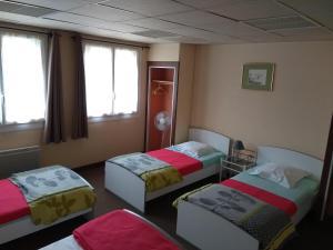 Un ou plusieurs lits dans un hébergement de l'établissement Résidence L'Ogomé