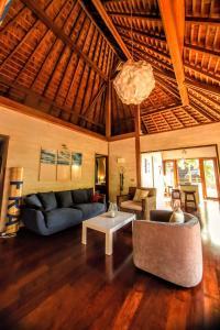 Uma área de estar em MOOREA - Villa Mahana Legends Residence