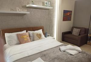 A bed or beds in a room at Casa Mia Alexandroupoli