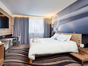 Łóżko lub łóżka w pokoju w obiekcie Novotel Kraków Centrum