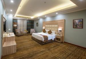Cama ou camas em um quarto em Iridium 70 Hotel