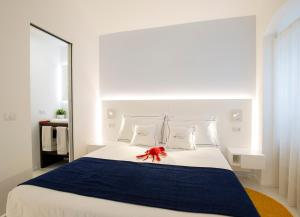 A bed or beds in a room at Al Castello Relais