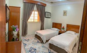 Cama ou camas em um quarto em الارجوان الراقية