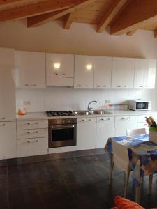 Kuchyň nebo kuchyňský kout v ubytování Residence Antares