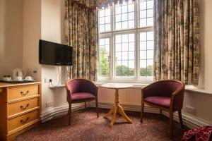 A seating area at Westone Manor Hotel
