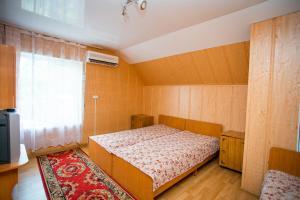 Кровать или кровати в номере Гостевой дом У Михалыча