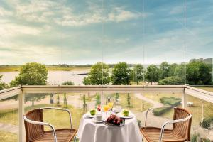 A balcony or terrace at Welcome Hotel Wesel