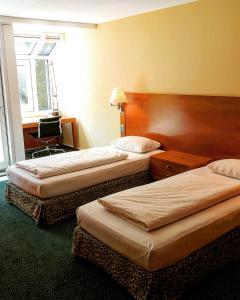 Ein Bett oder Betten in einem Zimmer der Unterkunft Hotel Residence Starnberger See