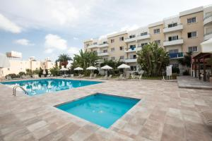 The swimming pool at or close to DebbieXenia Hotel Apartments
