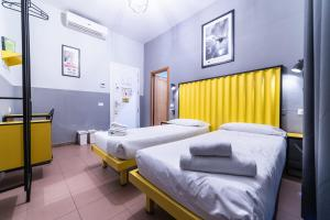 A bed or beds in a room at YellowSquare Rome