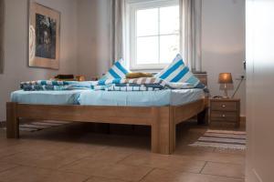 Ein Bett oder Betten in einem Zimmer der Unterkunft Ferienhaus Wasserfall