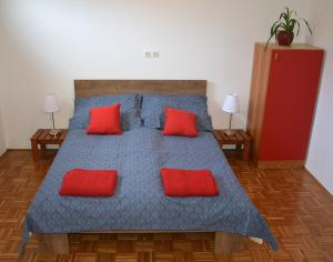 A bed or beds in a room at Apartma Vidmar