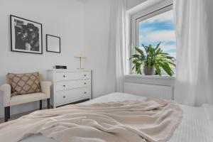 A bed or beds in a room at HARBOR coffee&stay