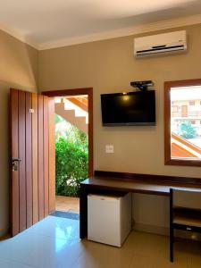 A television and/or entertainment center at Hotel Pousada Santa Rita