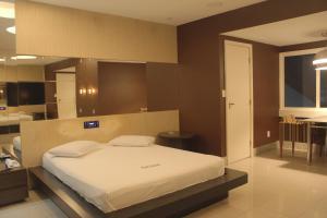 Cama ou camas em um quarto em Motel Hollywood