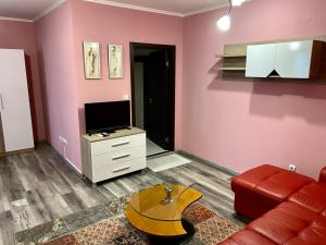A television and/or entertainment center at Modena rooms center of Stara Zagora