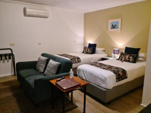 A bed or beds in a room at Oyster Cove Chalet