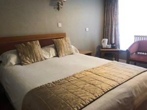 A bed or beds in a room at Trouville Hotel - OCEANA COLLECTION