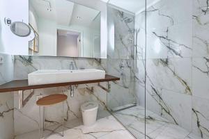 Ein Badezimmer in der Unterkunft Apartments Mondscheingasse