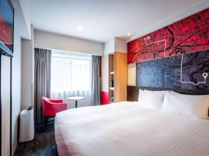 A bed or beds in a room at ibis Osaka Umeda