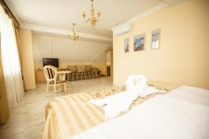 Кровать или кровати в номере Логер Хаус