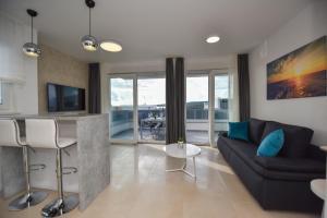 Posedenie v ubytovaní Pool Apartments & Rooms Mare