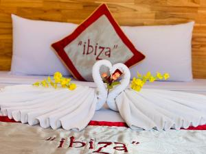 A bed or beds in a room at IBIZA Hostel