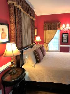 A bed or beds in a room at A Williamsburg White House Inn