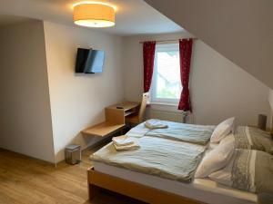 Posteľ alebo postele v izbe v ubytovaní Guesthouse Veranda
