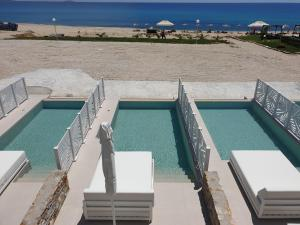 A view of the pool at Blue Dream Palace Trypiti Beach Resort & Spa or nearby