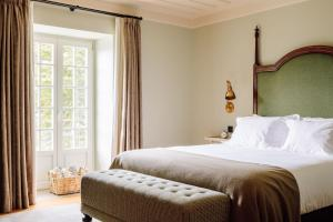 A bed or beds in a room at Quinta Nova Winery House - Relais & Châteaux