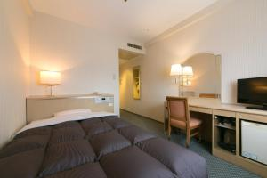 Tempat tidur dalam kamar di Tottori Washington Hotel Plaza
