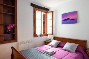 Un ou plusieurs lits dans un hébergement de l'établissement Casa Rural Areano