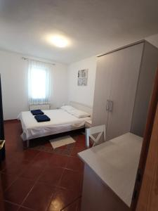 A bed or beds in a room at Apartments Porec Istria By Nina