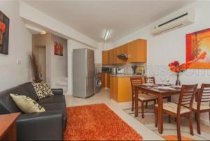 A kitchen or kitchenette at Pafilia Garden Apartments