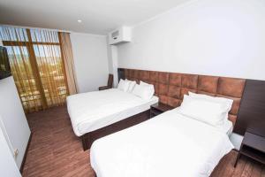 Кровать или кровати в номере Отель Шайн Палас