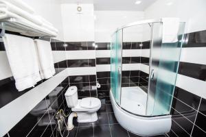 Ванная комната в Отель Шайн Палас