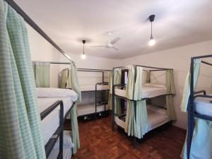 A bunk bed or bunk beds in a room at Mucha Masia Hostel Rural Urba