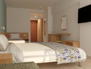 A bed or beds in a room at Sirena Hotel